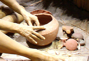 A diorama showing a Mississippian potter and h...
