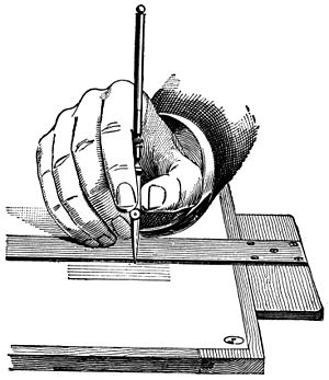 Holding a Ruling Pen.