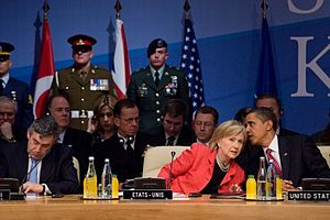 President Barack Obama confers with U.S.Secret...