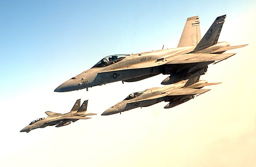 US Navy 040814-F-6740T-124 A pair of F-A-18C Hornets and an F-14B Tomcat fly in loose formation over Iraq