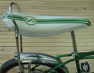 English: A Schwinn banana seat with sissy bar,...