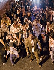 A group of actors portraying zombies.