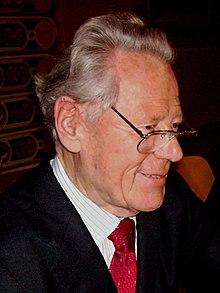 A profile of Hans Küng smiling