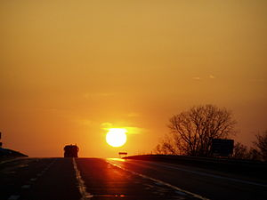 The sun sets over the westbound Ohio Turnpike.