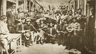 Photo of Rebetes in Karaiskaki, Piraeus (1933)