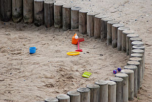 Detail of sandbox with toys