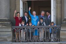 The Queen surrounded by her family waving to crowds on her 70th birthday in April 2010. From left to right: the Crown Princess, Prince Felix, the Crown Prince, Prince Christian, the Queen, Prince Nikolai, Prince Consort Henrik, Prince Joachim and Princess Isabella
