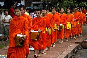 English: A procession of Buddhist monks walks ...