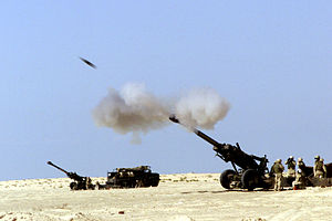 A 155 mm artillery shell hurtles out of the ba...