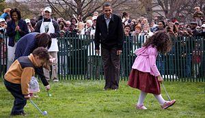 President Barack Obama cheers on children part...
