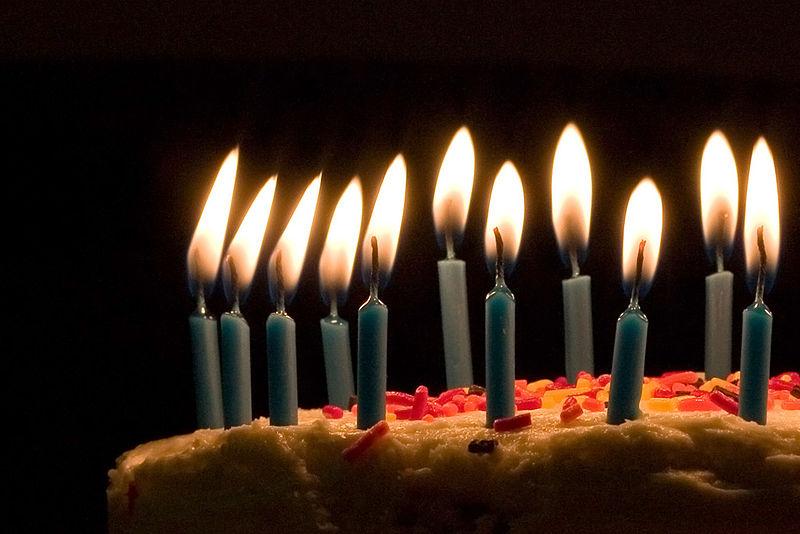 Blue candles on birthday cake