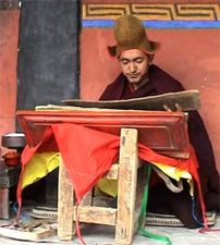 Buddhist monk Geshe Konchog Wangdu reads Mahayana sutras from an old woodblock copy of the Tibetan Kanjur.