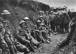 Mud stained British soldiers at rest