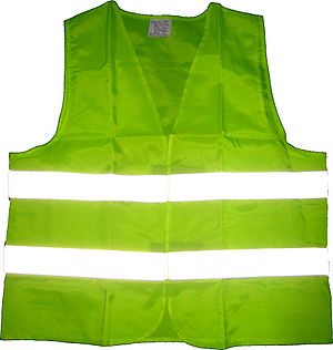 Fluorescent green vest with retroreflective strips