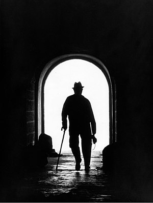 Old black and white photo of a man walking in ...