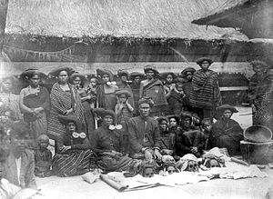 Karo-Batak man with family and the skulls of t...