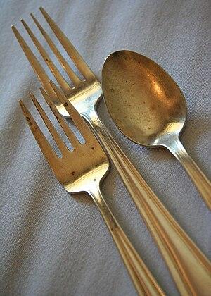 Silverware: salad fork, dinner fork, and spoon