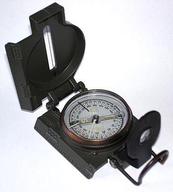 Liquid filled lensatic compass