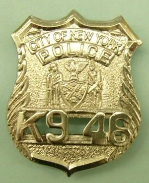 A badge of a police dog within the New York Po...