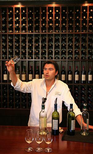 Preparing a flight of wines at a tasting bar