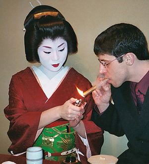 A geiko entertaining a guest in Gion (Kyoto)
