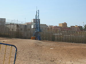 English: Border fence with guardpost at Spain-...