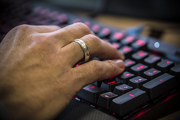 Operating a Computer Keyboard MOD 45158106.jpg