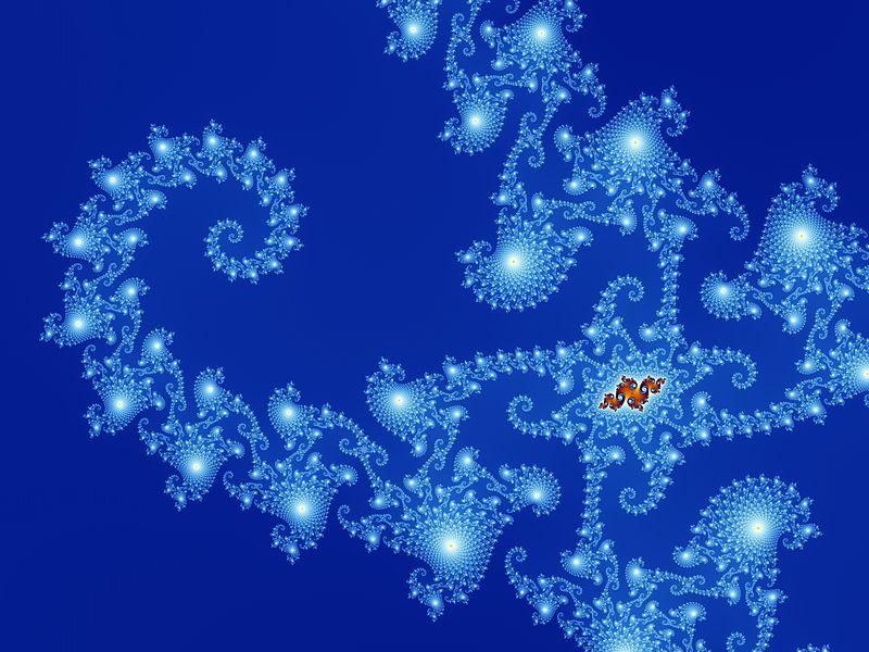 https://i0.wp.com/upload.wikimedia.org/wikipedia/commons/thumb/f/fb/Mandel_zoom_13_satellite_seehorse_tail_with_julia_island.jpg/800px-Mandel_zoom_13_satellite_seehorse_tail_with_julia_island.jpg