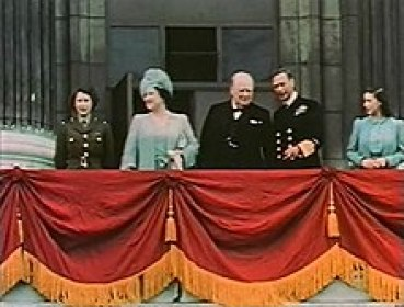 Princess Elizabeth (left, in uniform) on the balcony of Buckingham Palace with (left to right) her mother Queen Elizabeth, Winston Churchill, King George VI, and Princess Margaret, 8 May 1945