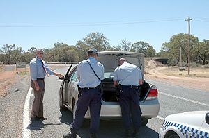 Police (from Dareton, NSW) search the vehicle ...