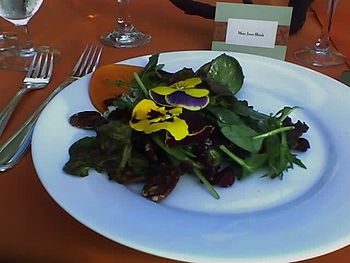 Salad with candied walnuts, persimmon slice, c...