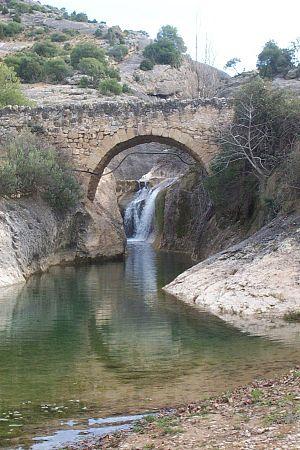Stone bridge on the river of Bordon after cros...