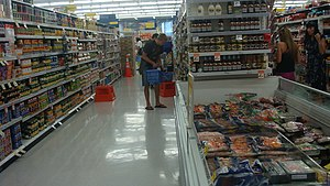 English: Food aisles (shelves and frozens) wit...