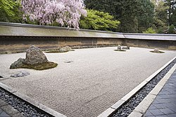 Rocks in Ryōan-ji (late 15th century) in Kyoto, Japan, a famous example of a zen garden