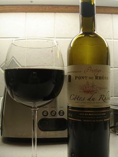 Bottle and glass of the French wine Cotes du R...