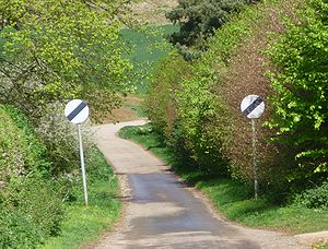 English: UK national speed limit signs on a co...