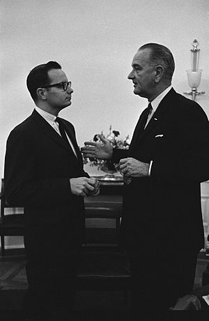 US President Lyndon Johnson (right) meets with...