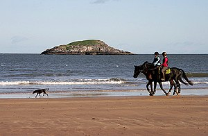 Horse riding on Broad Sands A couple of riders...