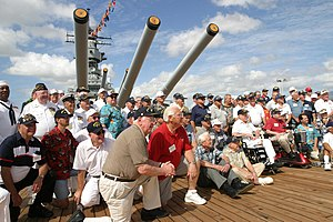 Former crew members of USS Missouri pose for p...