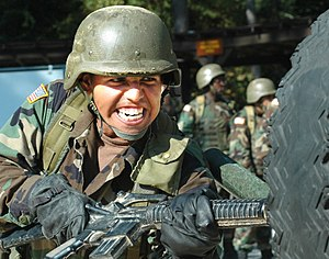 United States Army Pvt. Jose Hernandez rams a ...