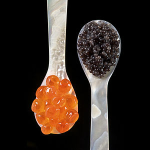 Mother of Pearl spoons with sturgeon caviar an...