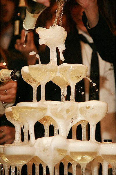A tower of champagne being poured into coupe glass at a club in Japan. By ori2uru