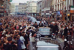 English: President John F. Kennedy greets spec...
