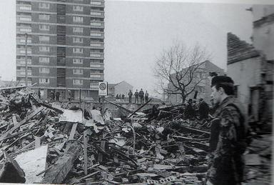 A British soldier surveys the aftermath of the...