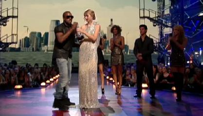 West taking the microphone from Swift at the 2...