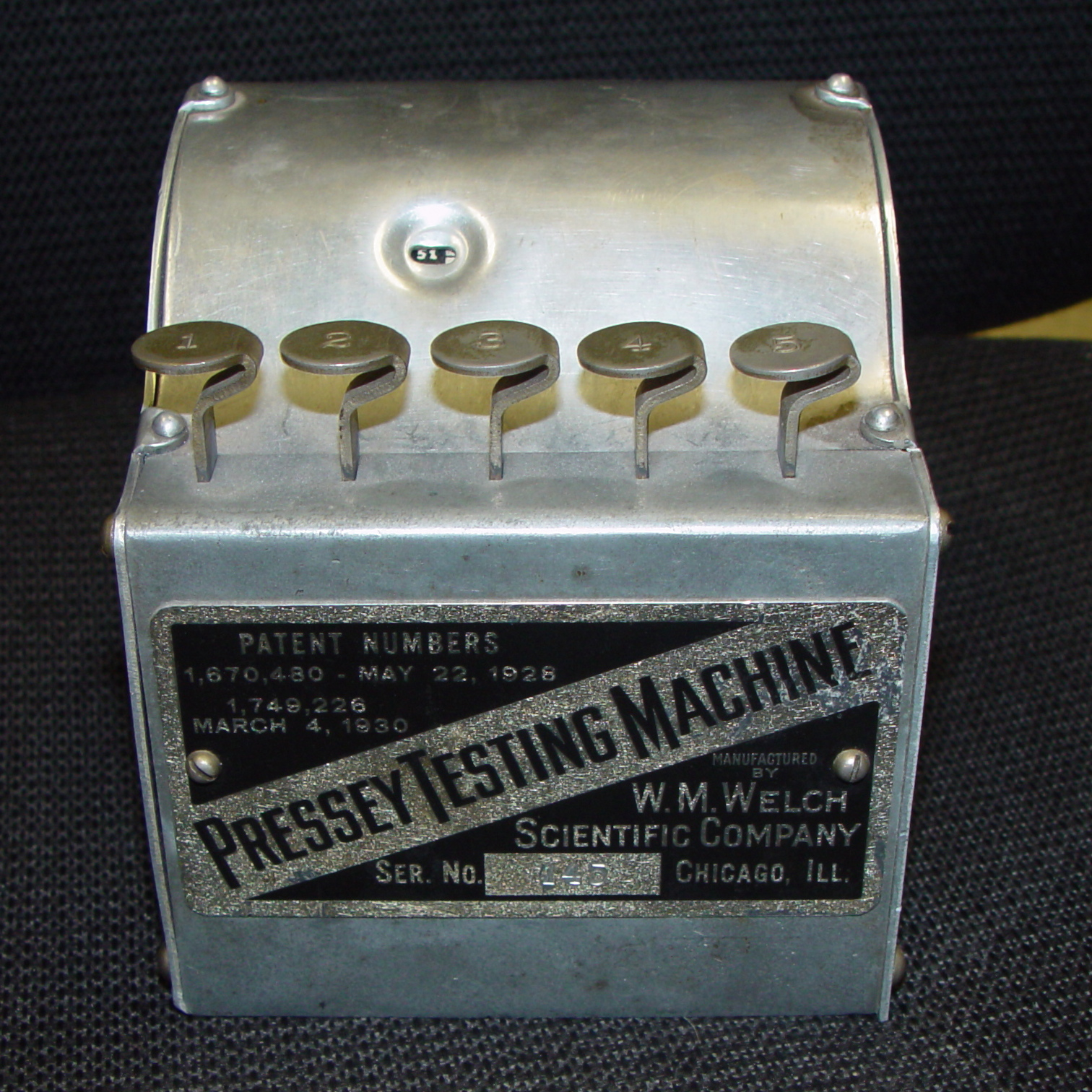 Exterior of Pressey Testing Machine, patent dates 1928 and 1930.