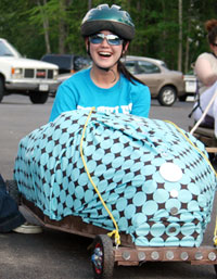 Student rides in car she built for art class