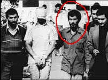 Iranian militants escort a blindfolded U.S. Ebmassy hostage to the media. (Do you recognize Ahmadinejad?)