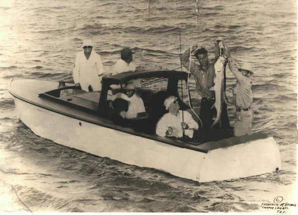 President Roosevelt catching a tarpon in Port Aransas, 1937. Barney Farley is holding the tarpon.