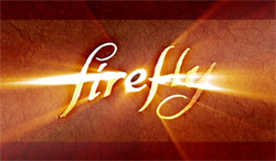 """The word """"Firefly"""" against a parchment background written in a golden illuminated flowing cursive script"""